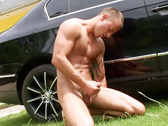 Handsome jimmy jerking off next to a car on a hot sunny day