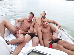 The triplets jerkin off their cock in a boat on a boring day